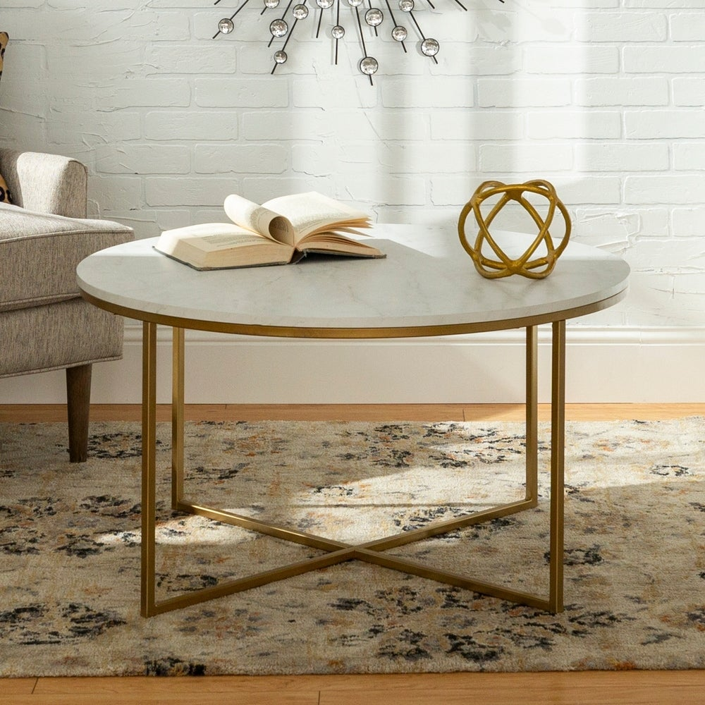 Silver-Orchid-Helbling-36-inch-Round-Coffee-Table-with-Gold-Metal-X-Base-36-x-36-x-19h-f2148adb-7ac5-4543-8a3a-220d323933a5_1000